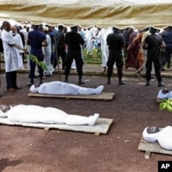 Bodies of people killed during a rally are seen at the capital's main mosque in Conakry, Guinea