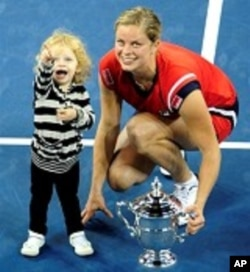 Kim Clijsters is joined by daughter Jada after beating Caroline Wozniacki during Women's final of 2009 US Open, 13 Sep 2009