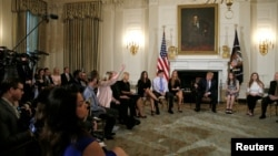 U.S. President Donald Trump hosts a listening session with Marjory Stoneman Douglas High School shooting survivors and students at the White House in Washington, Feb. 21, 2018.