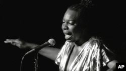 Nina Simone performs at Avery Fisher Hall in New York. Simone will be inducted into the Rock and Roll Hall of Fame on April 14, 2018 in Cleveland, Ohio, June 27, 1985.