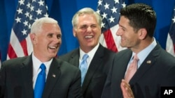 Republican vice presidential candidate Mike Pence, left, House Majority Leader Kevin McCarthy of California, center, and House Speaker Paul Ryan of Wisconsin laugh during a news conference following a meeting on Capitol Hill in Washington, Sept. 13, 2016.