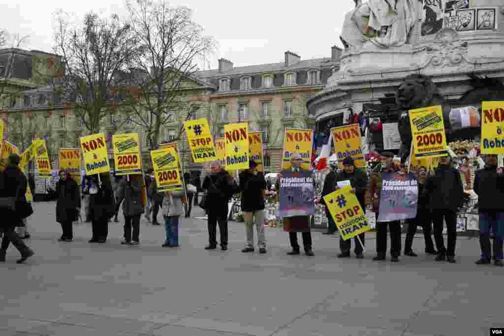 protest in paris against rouhani