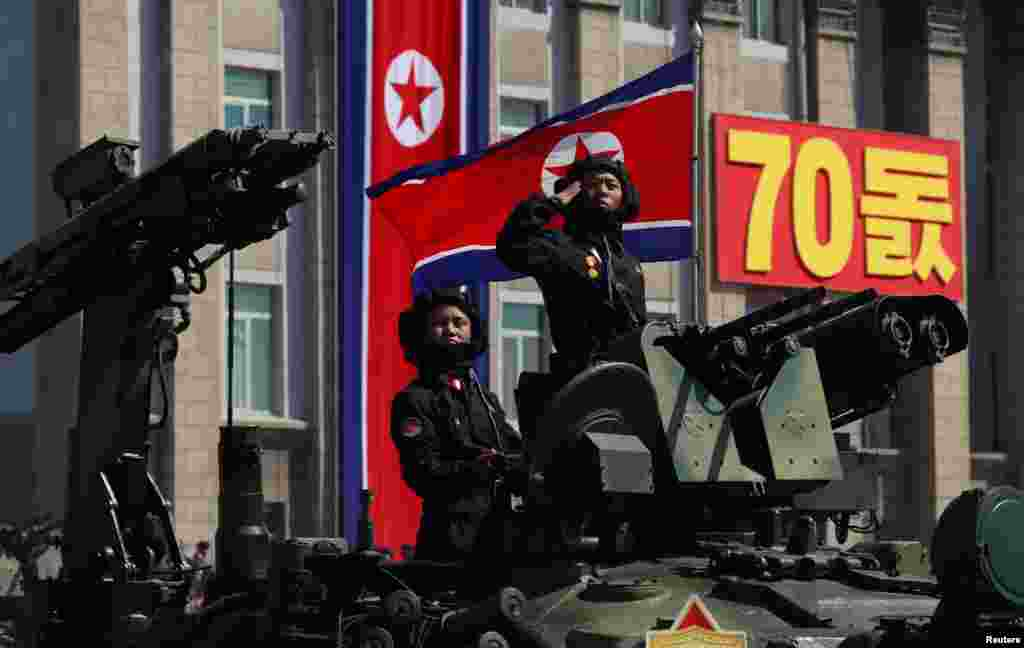 A soldier salutes as he rides a tank during a military parade marking the 70th anniversary of North Korea's foundation in Pyongyang, North Korea, Sept. 9, 2018.