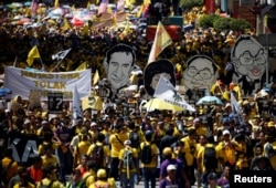 FILE - Pro-democracy group Bersih stage 1MDB protest, calling for Malaysian Prime Minister Najib Abdul Razak to resign, in Kuala Lumpur, Malaysia, Nov. 19, 2016.