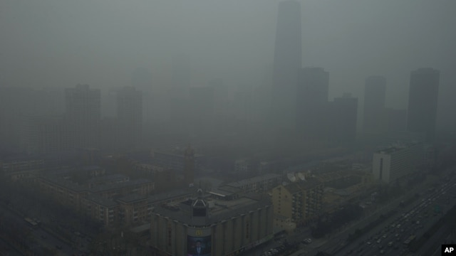 Skyscrapers are obscure by heavy haze in Beijing Jan. 13, 2013.