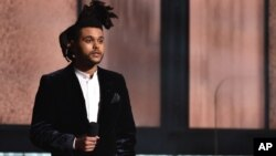 The Weeknd introduces a performance by Pharrell Williams at the 57th annual Grammy Awards, Feb. 8, 2015, in Los Angeles.