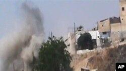 20일 정부군과 반군간 교전이 계속되는 시리아 홈스 시.