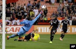 "FILE -- DC United goalkeeper Bilal ""Bill"" Hamid (28) reaches for the ball during a MLS game."