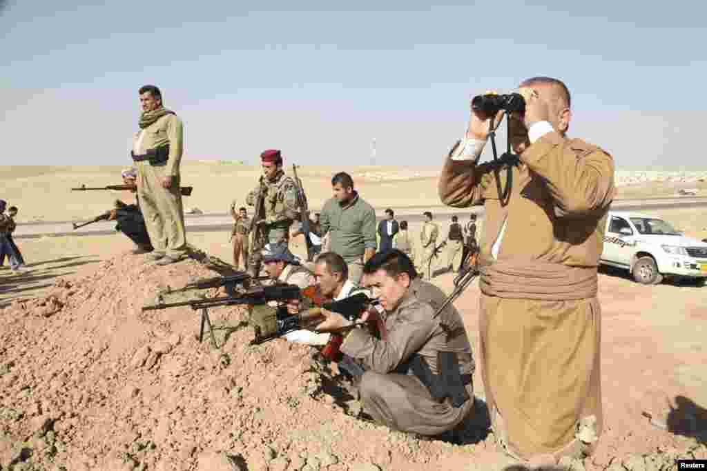 "Kurdish peshmerga troops participate in an intensive security deployment against Islamic State militants on the front line in Khazer. U.S. warplanes bombed Islamist fighters marching on Iraq's Kurdish capital after President Barack Obama said Washington must act to prevent ""genocide""."