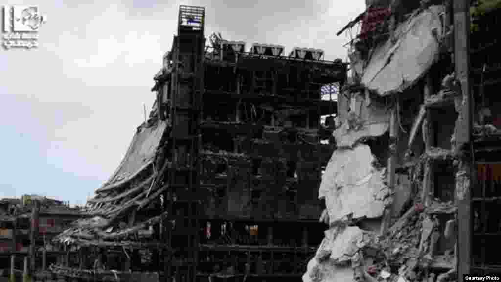 Destruction is seen on Sa'ad Allah Al-Gabri Street in Homs' Al-Qusayr district, January 30, 2013 (Lens Young Homsi)