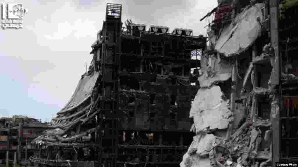 Các tòa nhà bị phá hủy trên đường Sa'ad Allah Al-Gabri ở thành phố Homs, ngày 30/1/2013.