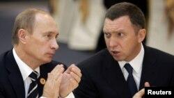 Президент Путін та російський металевий магнат Олег Дерипаска, щодо якого санкції США залишаються чинними