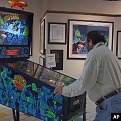 David Silverman, owner and curator of the National Pinball Museum plays one of the machines on exhibit