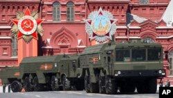 FILE - Iskander missile launchers are part of the Victory Parade marking the 70th anniversary of the defeat of the Nazis, in Red Square in Moscow, Russia, May 9, 2015. Russia airlifted its state-of-the art Iskander missiles to the Kaliningrad region in a show of its rapid deployment capability.