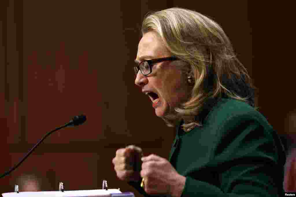 U.S. Secretary of State Hillary Clinton pounds her fists as she responds to intense questioning on the September attacks on U.S. diplomatic sites in Benghazi, Libya, during a Senate Foreign Relations Committee hearing on Capitol Hill in Washington, D.C.
