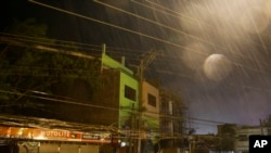 Strong winds and rain batter buildings and business establishments as Typhoon Mangkhut hits Tuguegarao city, Cagayan province, northeastern Philippines, Sept. 15, 2018. Typhoon Mangkhut slammed into the country's northeastern coast early Saturday.