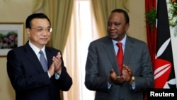 Chinese Premier Li Keqiang, left, and Kenyan President Uhuru Kenyatta applaud signing of a Standard Gauge Railway agreement at the State House in Nairobi, May 11, 2014. Fraud has been alleged in a railway deal.