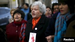 Veronica De Negri (C), mother of 19-year-old U.S. student Rodrigo Rojas who was burned alive and killed during a Santiago labor strike in 1986 along with Carmen Gloria Quintana (R) who suffered serious injuries, and Alicia Lira, relative of a human rights case, shout slogans before delivering a letter to Chile's President Michelle Bachelet (not pictured) to demand justice outside the government palace in Santiago, July 31, 2015.