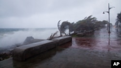 Strong winds and waves batter the coast as Tropical Storm Erika approaches Santo Domingo, Dominican Republic, Aug. 28, 2015.