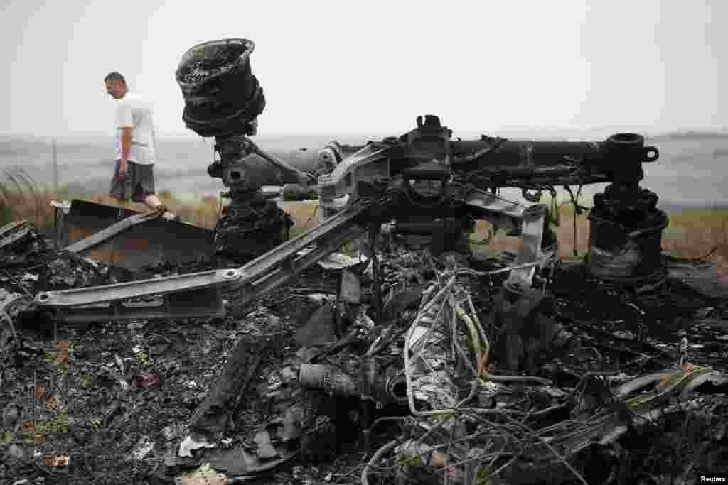 Debris is pictured at the site of the Malaysia Airlines Boeing 777 plane crash, near the village of Grabovo, in the Donetsk region, July 18, 2014.