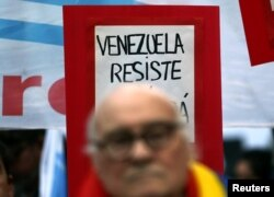 "A sign that reads ""Venezuela, resist"" is seen behind former Argentine leftist guerrilla leader Roberto Perdia during a protest in support of Venezuela's government in Buenos Aires, Argentina, Aug. 17, 2017."