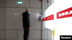 A man has his face scanned by a facial recognition device that identifies people when they wear masks to gain entrance to the office of Chinese electronics manufacturer Hanwang Technology in Beijing. Picture taken March 6, 2020. (Reuters/Thomas Peter)