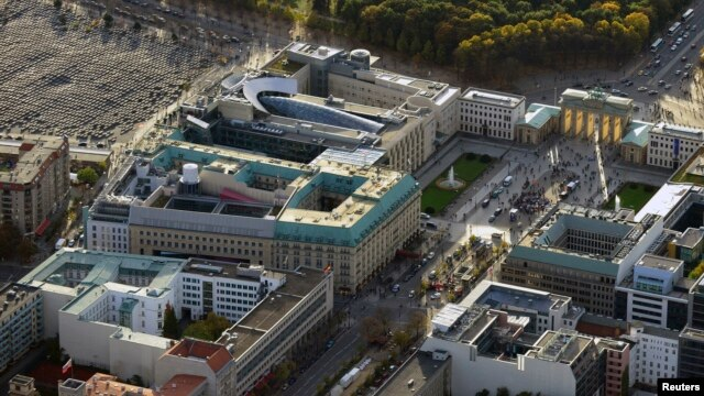 FILE - An aerial view over the British embassy (c), Hotel Adlon (lower l), the Academy of Arts and the U.S. Embassy (top), between the Holocaust memorial (top L) and the public square Pariser Platz, with the Brandenburg Gate (top r) toward the Tiergarten