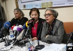FILE - Aida Seif el-Dawla, Suzan Fayyad, center, and Magda Adly, right, co-founder of El Nadeem Center for Rehabilitation of Victims of Violence, hold a press conference in Cairo, Feb. 21, 2016. On Feb. 9, 2017, Egypt's police closed the El-Nadeem Center, a rights organization that documents alleged abuse of detainees by Egyptian police and security agencies.