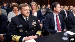 FILE - National Security Agency Director Admiral Michael Rogers (L) and FBI Director James Comey, testify before a congressional panel on Capitol Hill in Washington, Feb. 9, 2016. On Monday, lawmakers will question Rogers and Comey on allegations of Russia's meddling in the 2016 presidential election and President Donald Trump's claim that president Barack Obama had his phones tapped during the campaign.