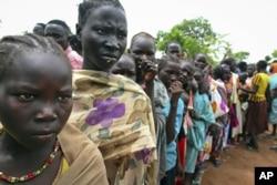FILE - Female child refugees who escaped violence queue up inside Yida refugee camp, South Sudan, June 30, 2012.