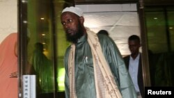 FILE - A former top leader of al-Shabaab, Mukhtar Robow, arrives for a news conference in Mogadishu, Somalia, Aug. 15, 2017.