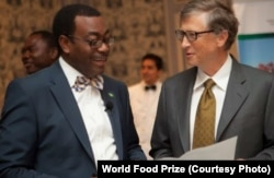 African Development Bank President Akinwumi Adesina, recipient of the 2017 World Food Prize, speaks with U.S. philanthropist Bill Gates.