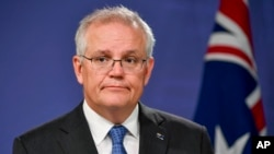 Perdana Menteri Australia Scott Morrison berbicara kepada media di Sydney, Australia, Senin, 19 April 2021. (Foto: AP)