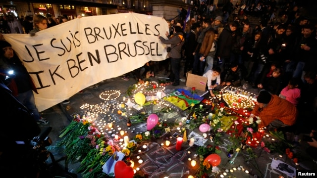 "People display a solidarity banner in Brussels following bomb attacks in Brussels, Belgium, March 22, 2016.  Banner reads ""I am Brussels"" in French and in Flemish languages."