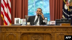 FILE - An official White House photograph released on September 27, 2013, shows President Barack Obama talking on the phone in the Oval Office.