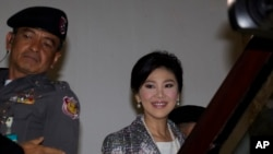 FILE - Thailand's former Prime Minister Yingluck Shinawatra, arrives at parliament in Bangkok, Thailand.