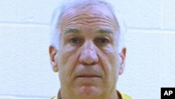 In this booking photo released early Saturday morning June 23, 2012 by the Centre County Correctional Facility in Bellefonte, Pa., former Penn State University assistant football coach Jerry Sandusky is shown.