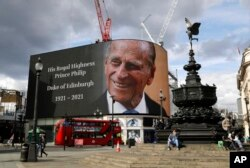 A tribute to Britain's Prince Philip is projected onto a large screen at Piccadilly Circus in London, after the announcement of the duke's death.
