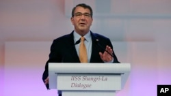 "U.S. Secretary of Defense Ashton Carter delivers his speech about ""The United States and Challenges to Asia-Pacific Security"" during the 14th International Institute for Strategic Studies Shangri-la Dialogue (IISS) Asia Security Summit, May 30, 2015, in S"