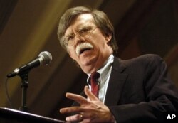 FILE - John Bolton, the U.S. ambassador to the United Nations, speaks to the Baltimore Council on Foreign Affairs in Baltimore, May 19, 2006.