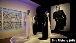 In this photo taken Thursday, Sept. 20, 2018, praying ensembles and dresses are displayed in the exhibit Contemporary Muslim Fashions at the M. H. de Young Memorial Museum in San Francisco.
