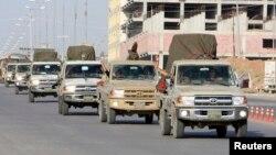 """10月28日,伊拉克庫爾德人組織""""自由鬥士""""的成員奔赴敘利亞境內的科巴尼。"""