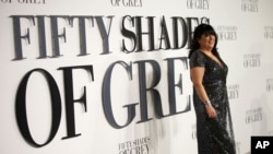 "FILE - Author E.L. James poses for photographers at the British premiere of the film ""Fifty Shades of Grey"" in London, Feb. 12, 2015."
