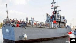 Migrants arrive on a Maltese Navy ship at the Valletta harbor, Malta, Oct. 12, 2013.