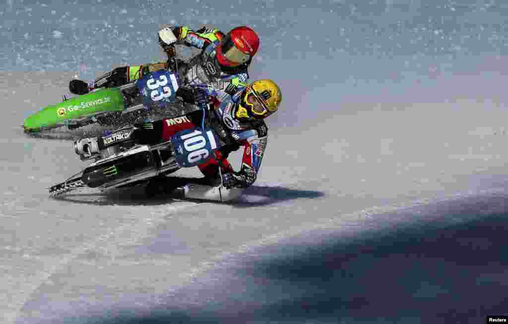 Johan Weber of Germany and Dmitry Koltakov of Russia compete during the final round of the FIM Ice Speedway Gladiators World Championship at the Medeo rink in Almaty, Kazakhstan.