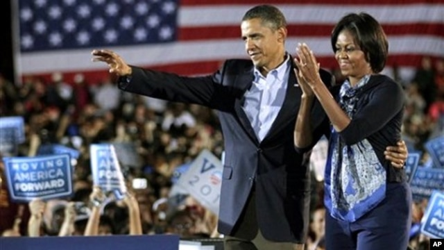 President Barack Obama and first lady Michelle Obama muster support for Democratic candidates during a rally at Ohio State University in Columbus, Ohio, 17 Oct. 2010.
