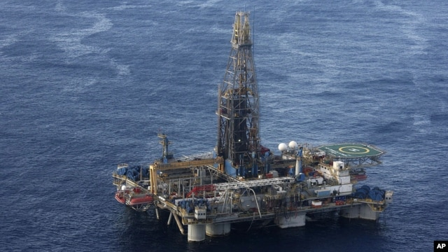 In this photo provided by the Cyprus Press and Information Office, the Noble Energy company's offshore oil and gas rig is seen some 185 kilometers off Cyprus' south coast, Monday, Nov. 21, 2011.