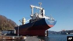 The 6,000-ton 'Asia Symphony' was washed onto the Kamaishi docks by the tsunami