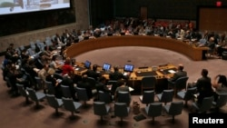 FILE - A U.N. Security Council meeting at U.N. headquarters in New York, July 31, 2014.