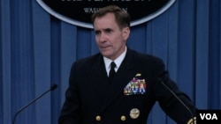 FILE- Pentagon spokesman Rear Admiral John Kirby speaks at a news briefing about the situation in Iraq, at the Pentagon, June 13, 2014.